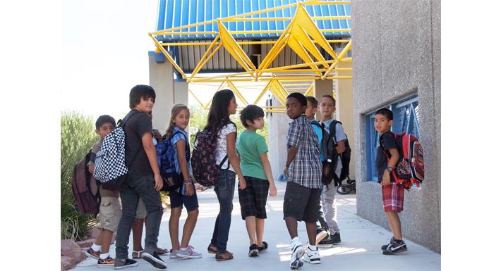 students walk into a school