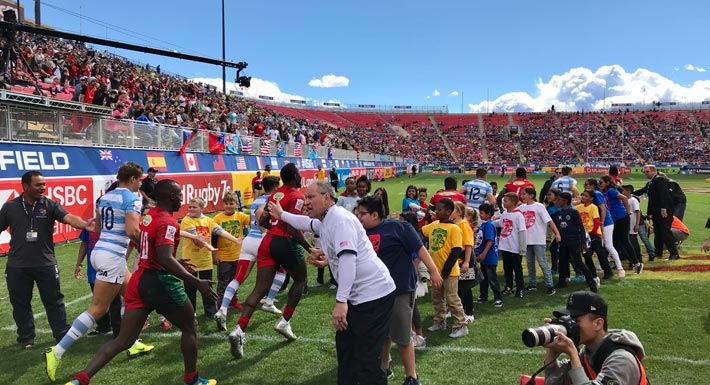 CCSD students greet rugby players on field