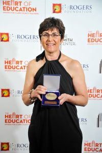 Gayle Miller with her Heart of Education medal