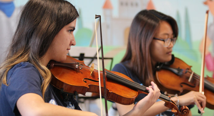 Centennial HS orchestra students perform at Divich ES' dedication ceremony